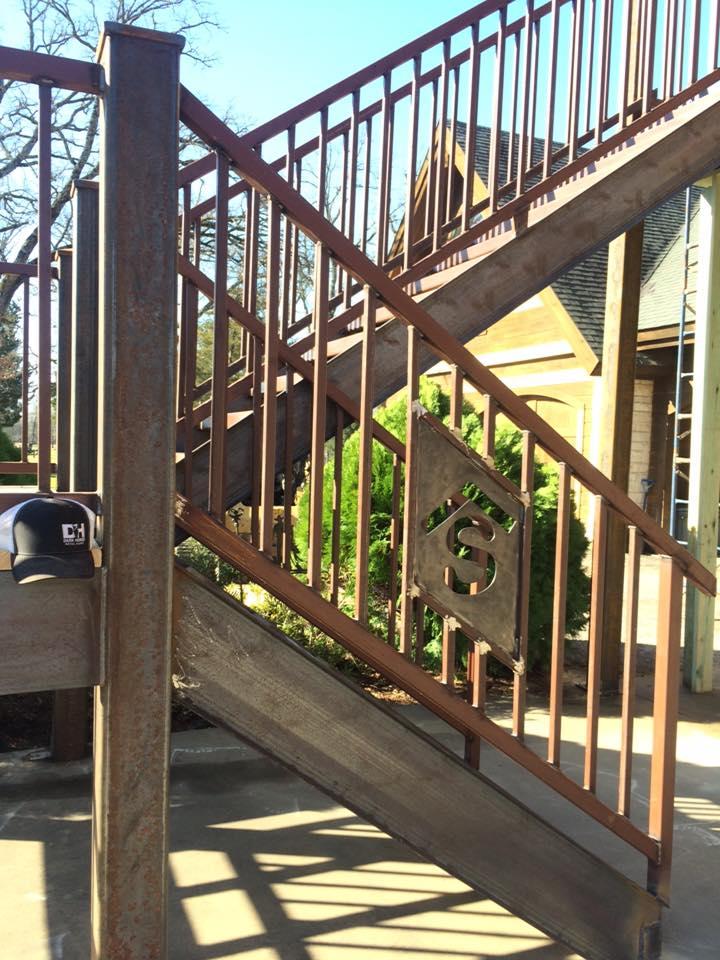 Monogram detail in stair railings