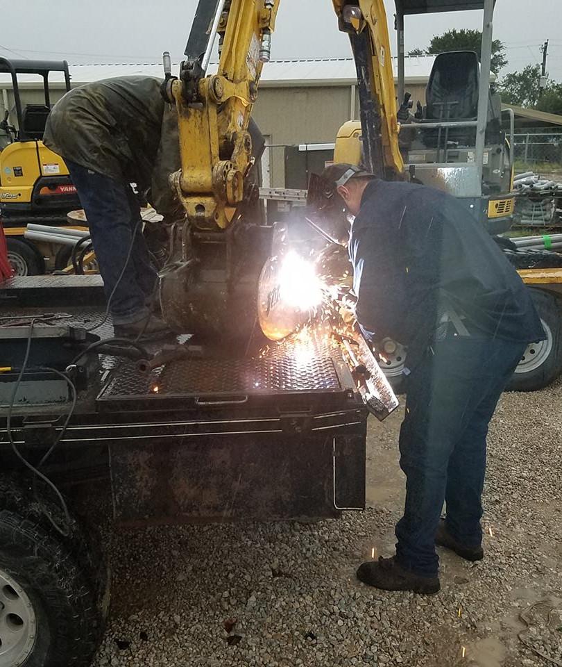Welding a Repair on an Excavator