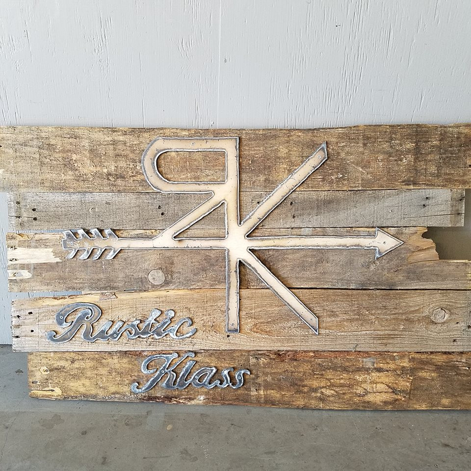 Metal and reclaimed wood sign for a local business. Attract customers with custom designs that show your style.