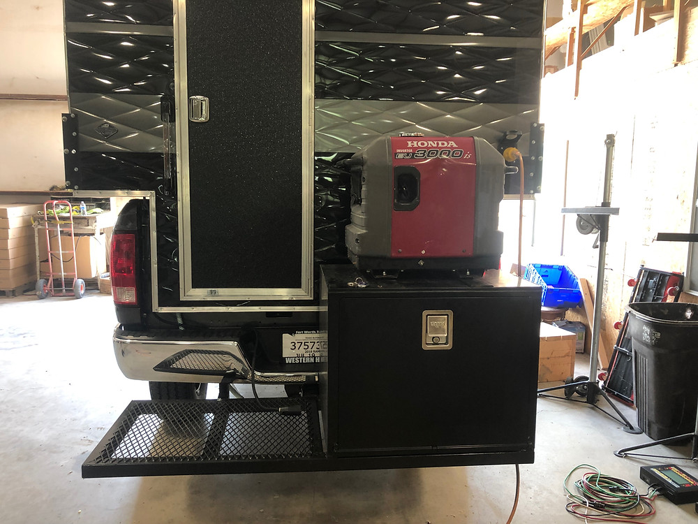 Custom built metal box for a generator on the back of a truck
