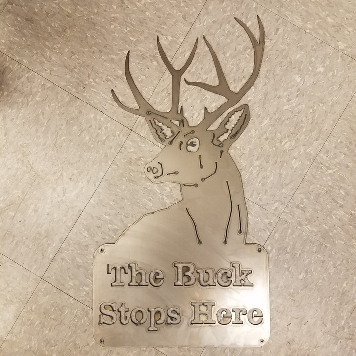 sign - the buck stops here