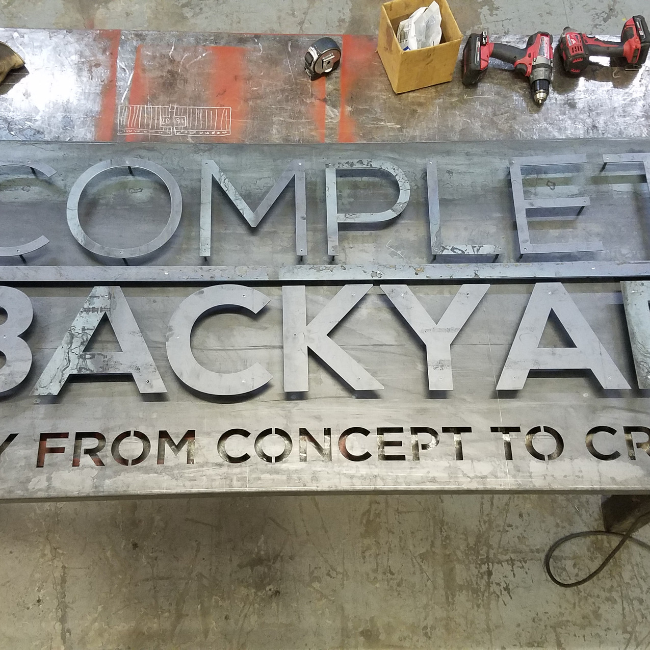 The Complete Backyard sign