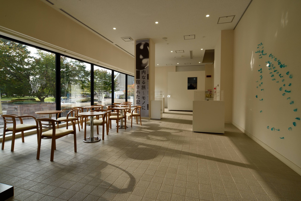installation view at the entrance of the museum  /  Four stories of a valley and Moveble mountain