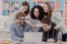 group-of-students-connecting-with-a-lapt
