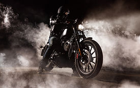 Dark motorcycle driver in fog. Wallpaper