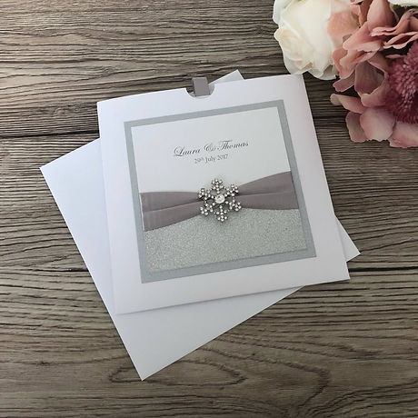 Wallet style invitation with diamante snowflake