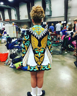 Kenzie giving us a view of her spectacular cape! New dress and a great feis day, earning 5th on her