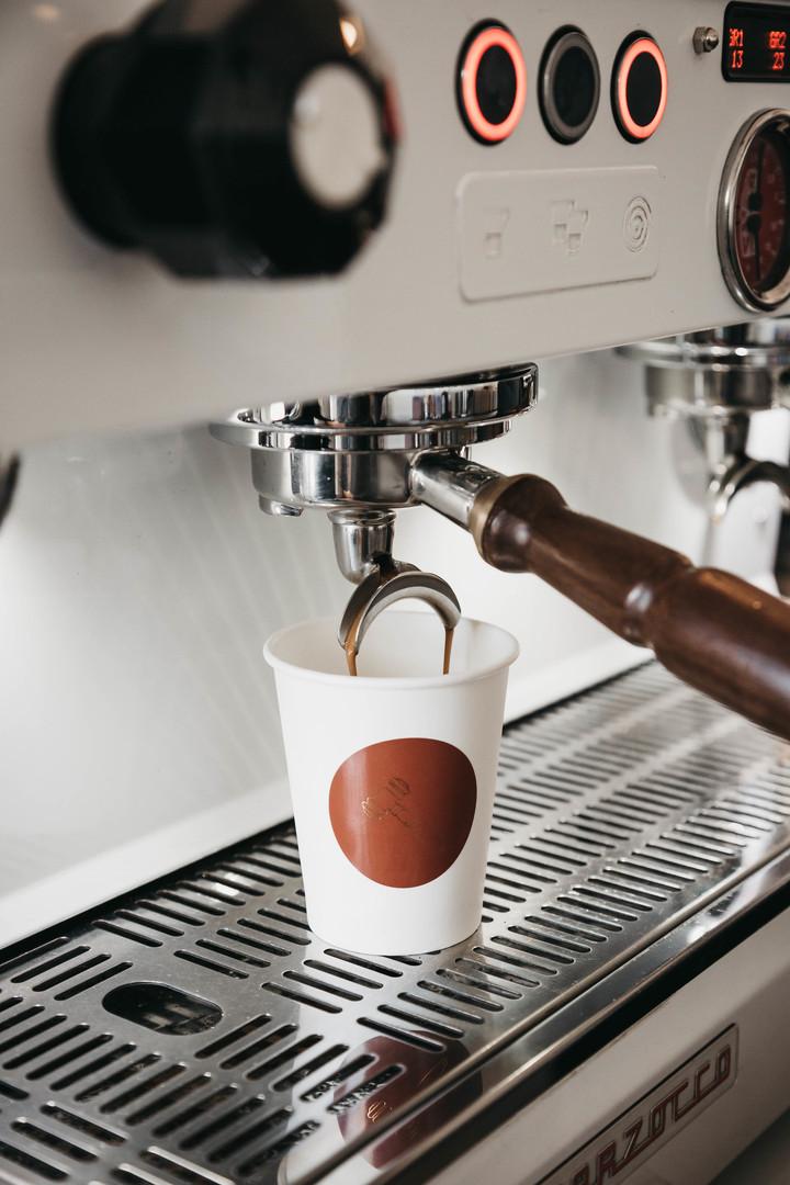AUC Coffee Cup & Machine.jpg