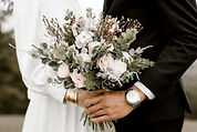 wedding flowers and hands.jpg