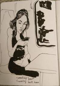 Young woman on train using her mobile