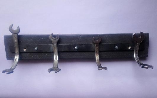 Handcrafted spanner coat rack on grey pallet wood