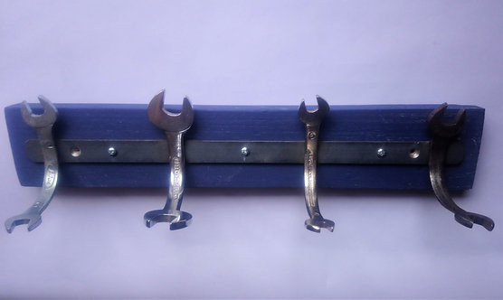 Handmade spanner coat rack on blue pallet wood backing