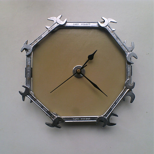 Reclaimed spanner wall clock on mocha background