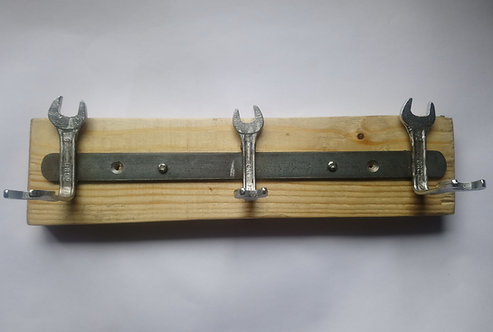 Three spanner coat rack on pallet wood backing