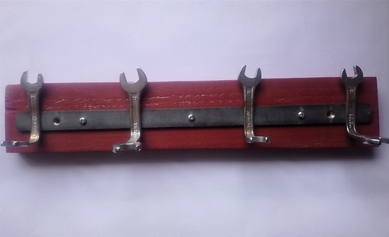 Handmade spanner coat rack on red pallet wood