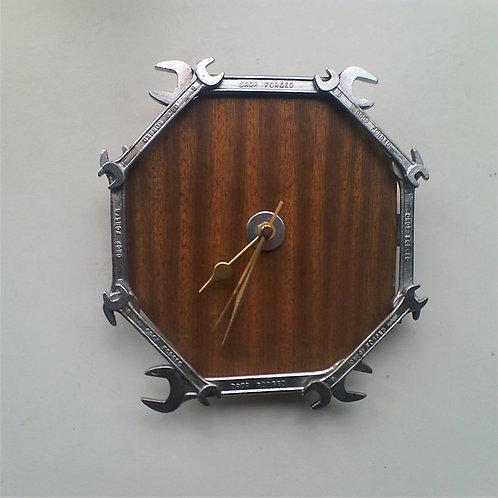 Reclaimed spanner clock on dark wood background