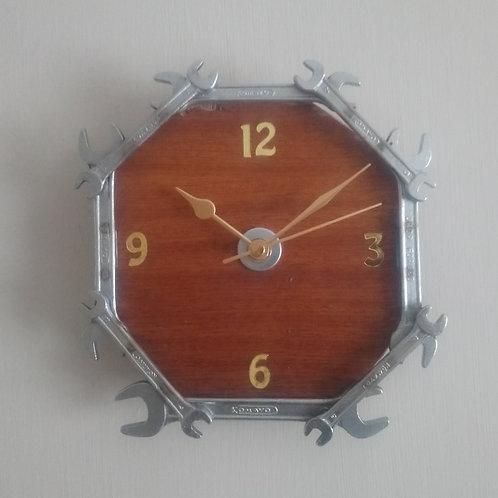 Reclaimed spanner wall clock on dark wood