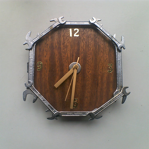 Reclaimed spanner clock on wood background