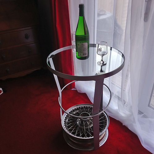 Optical illusion Jaguar wire wheel side table