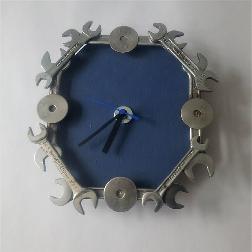 Industrial spanner wall clock with blue background