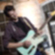 Adam Rogerson playing guitar