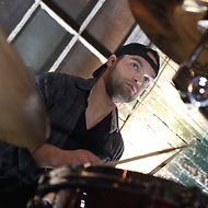 Luke Omond playing the drums