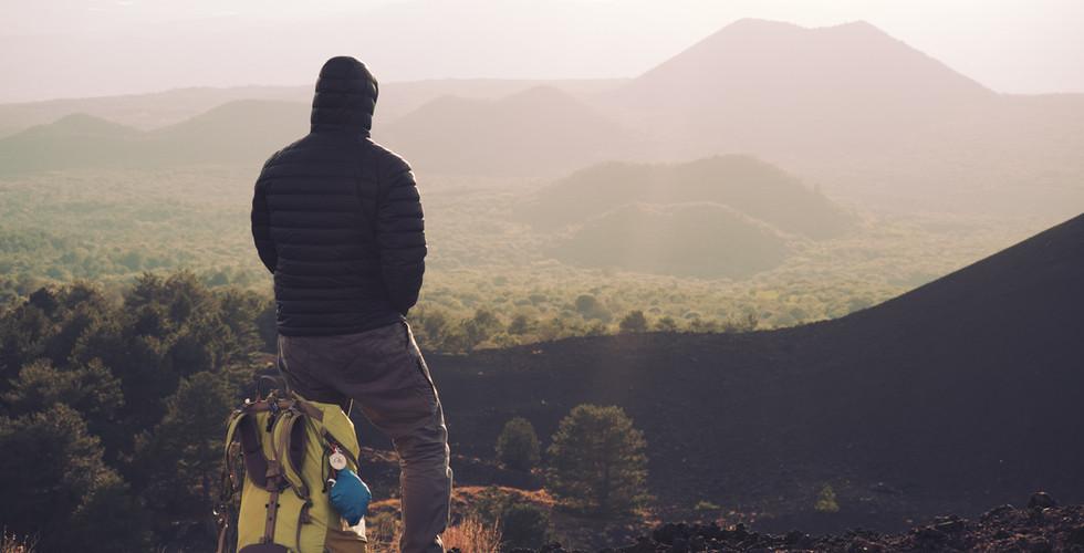 hiker with backpack enjoying sunset on o