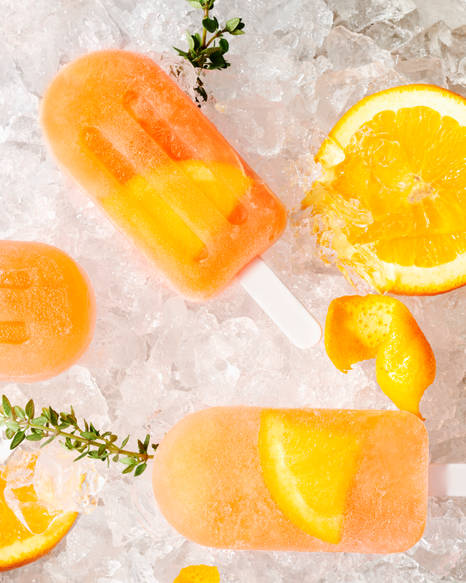 Studio commercial photography of Aperol Spritz popsicles
