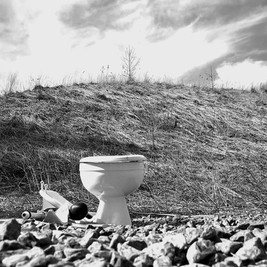 A toilet left on side of the road. Colonie NY