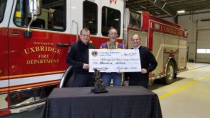 Cheque Donation to firefightersStatue.jp
