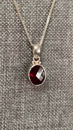 Faceted Oval Garnet & Sterling Silver Pendant