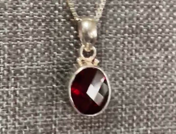 Sterling Silver and Faceted Oval 10x12mm Garnet