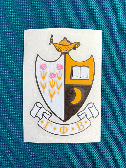 Gamma Phi Beta crest layered in pink, yellow, brown, white