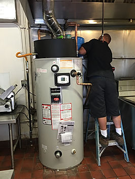 photo installing commercial water heater