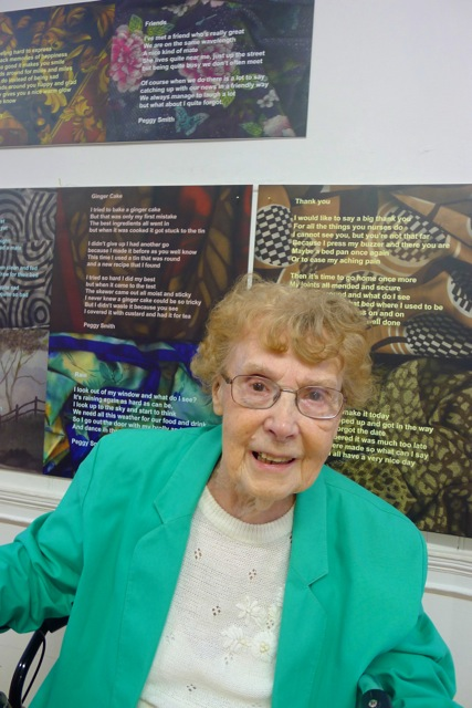Peggy proud in front of her poems