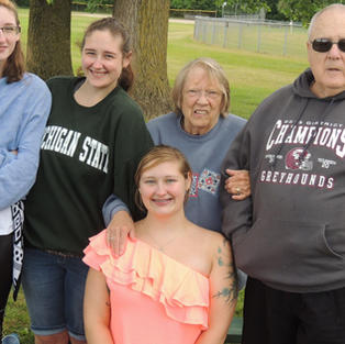 Cindy her husband Dean and her 3 granddaughters