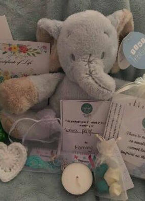 Picture of pregnancy loss keepsakes you can request, the example is a teddy, candle and certificate