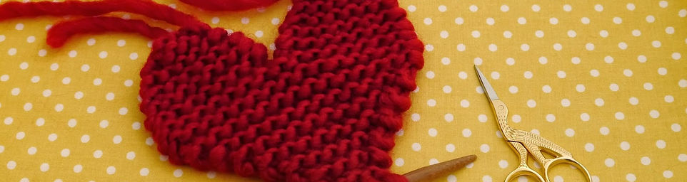 picture of a half finished knitted heart