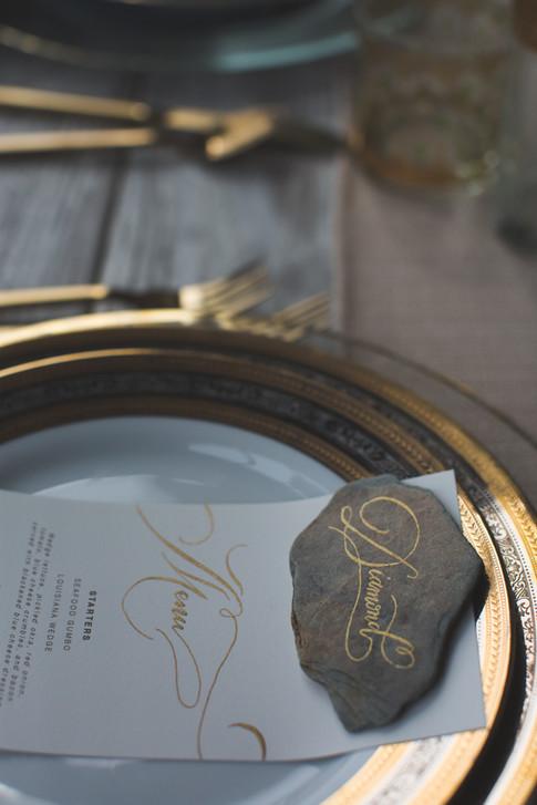 Wedding Table Setting Gold Calligraphy Place Card Stone Menu.jpg