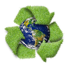 Recycle logo symbol from the green grass