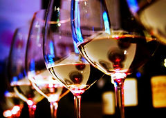 wine drinking, colorful glass glasses, fluorescent bar