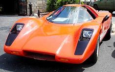 tangerine colored automobile