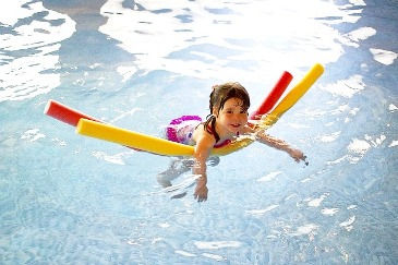 child swimming, pool hotel amenities