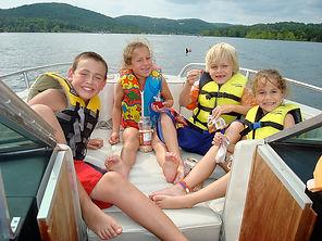 bull shoals, table rock, kids eating snacks, kids wearing life jackets