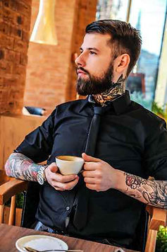 visible tattoos in the workplace, should tattoos be allowed in the workplace, tattooed man