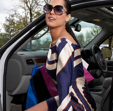 tanger outlet coupons, chic styles, getting in the car, holding shopping bags