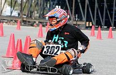 kid driving go kart, orange road cones