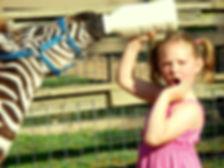 interactive zoos, feeding a baby zebra, shocked girl, bottle feeding animal
