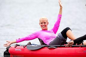 happy girl kayking, boat racing finish line