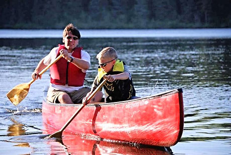 missouri lake activities, father and son canoeing, lake taneycomo boat